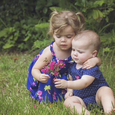 sisters looking at flowers