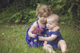 sisters looking at flowers
