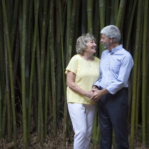 couple in front of bamboo