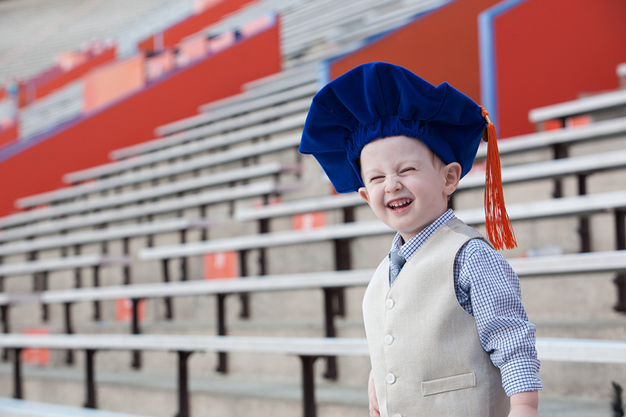 kid with graduation cap