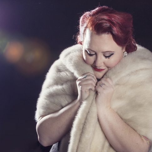 woman photographed in studio with fur coat