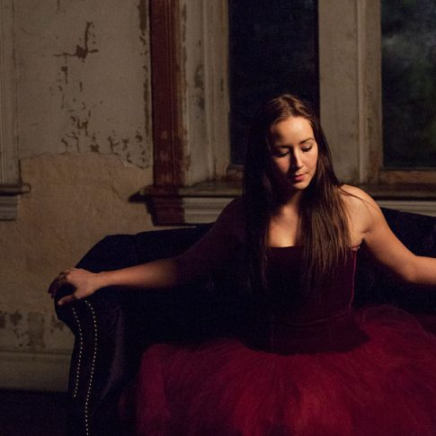 woman in tutu on couch at night
