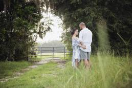 engaged couple in grass at state park