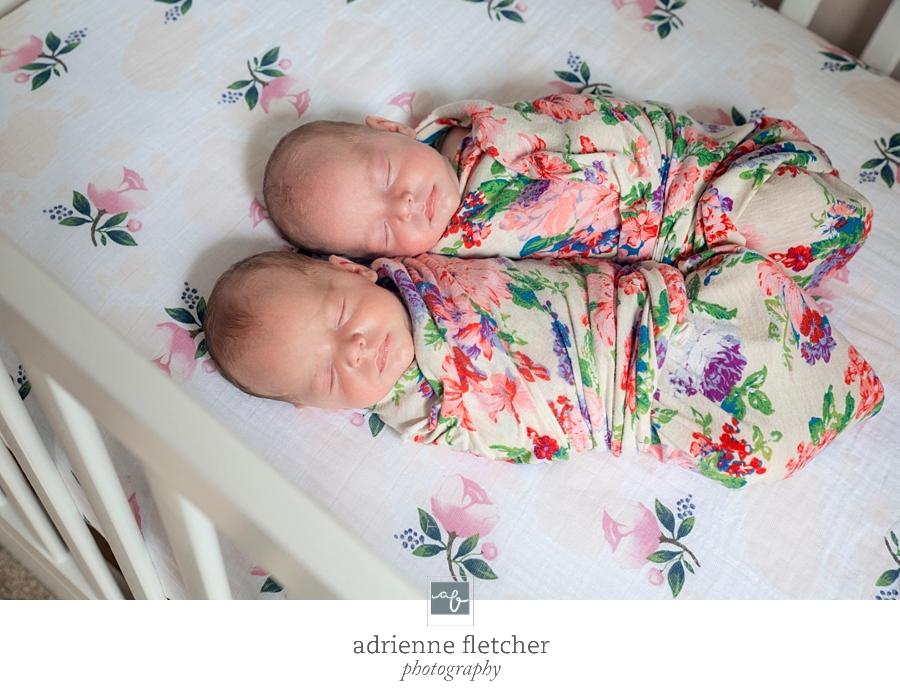 newborn twins in their crib