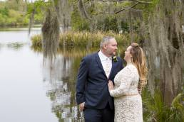 Bridal couple in front of Lake Alice