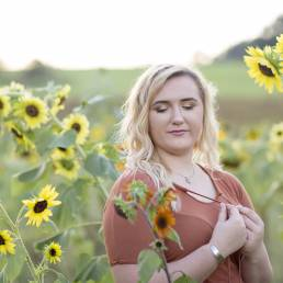 high school senior in sunflowers