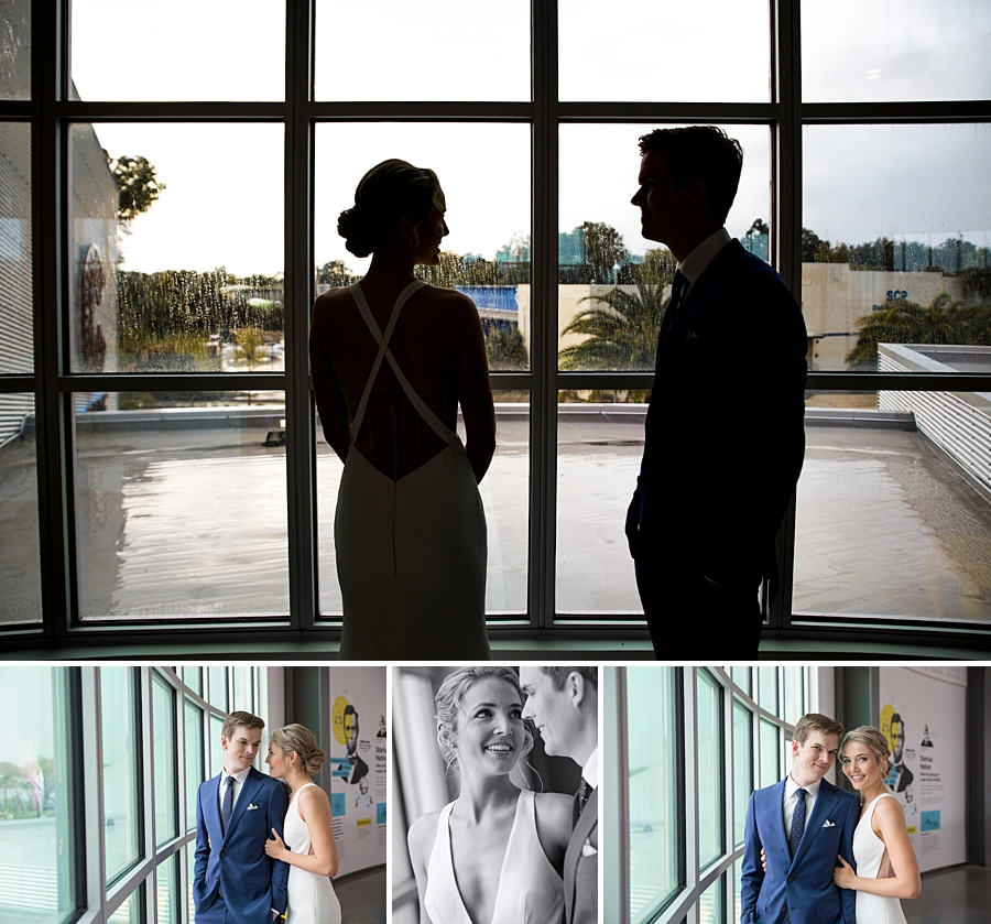 bride and groom near windows