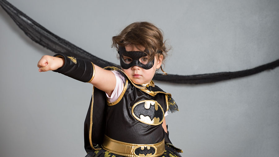 little girl dressed up at batman
