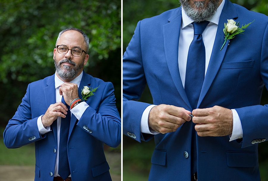 Groom putting finishing touches to his suit